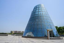 Download Cone-shaped Modern Building With Blue Glass Curtain Wall In Sunn  Stock Photo -