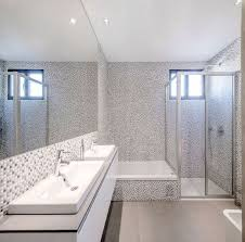 wall mosaic ceramic tiles simple modern bathroom design with white interior color decorating ideas plus double wash basin and glass room divider