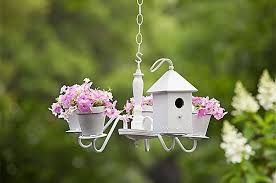 with just a few tweaks to a rummage find you can create this elegant planter that also doubles as a birdhouse