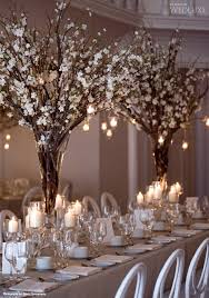 just branches and candles centerpieces - gorgeous WedLuxe Magazine