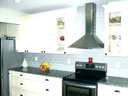 white kitchen cabinets with blue glass backsplash blue glass white kitchen blue glass coastal tiles nautical