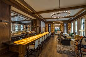 backlit bar features aria stone gallery s onyx caramello at the grove restaurant
