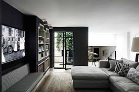 Monochrome TV Room with Black Walls in Living Rooms on HOUSE. A west London  home