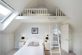 Example of a classic loft-style bedroom design in London