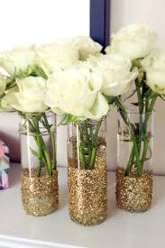 Glitter Shot Glass Vases: Add some glitter to shot glasses for a DIY gift  that could function as shot glasses or gorgeous vases.