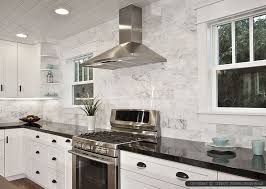 black countertop white marble subway backsplash tile