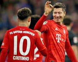 Philippe Coutinho down with the kids at Bayern Munich in children's size  home shirt