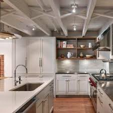 exposed lighting. brownstone gardenlevel kitchen with exposed ceiling joists lights would be mounted from floorceiling wood floor shelves are nice lighting