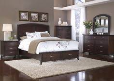 Grey walls with dark wood bedroom furniture