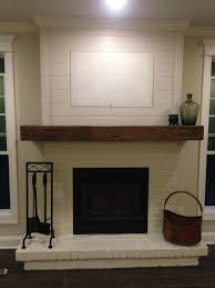 Railroad Tie Mantle painted brick wood mantel and shiplap minus the hidatv 4346 by xevi.us
