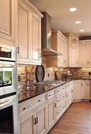 Light Cabinets, Dark Counter, Oak Floors, Neutral Tile Black Splash.   But  With Dark Backsplash