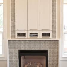 Fireplace tiled in Tranquilo Light Grey Shiny & Matte Glass