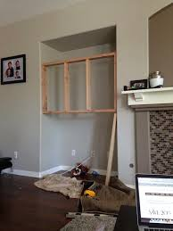 diy entertainment center shelving this was the frame we built to dry wall and mount the tv too