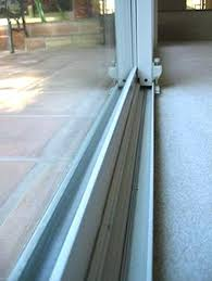 sliding glass door track replacement sill cover why does my fills with water sliding glass door track