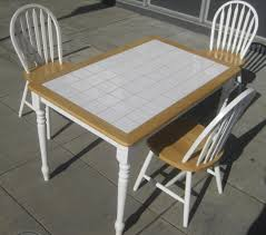 SOLD - Tile Top Table and Three Chairs - $90