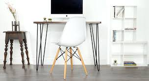 Small office desks Designer Photo Of Stylish Small Desk In The Living Room Home Stratosphere Top 10 Small Home Office Desk Ideas For 2019