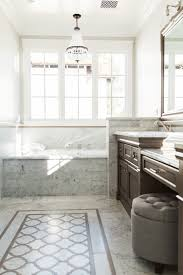 Built In Soaking Tub With Marble Surround And Marble Floor