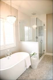 full size of chandelier cheerful chandelier over bathtub with bathroom lighting fixtures over mirror and