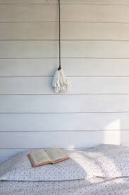 a detail of shiplap in sheila bonnell s guest room shows the distinct gaps between
