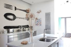 an oversize whimsical print wallpaper in the ney house n16 kitchen featured on locations site
