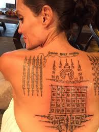анджелина джоли и брэд питт до развода сделали татуировки
