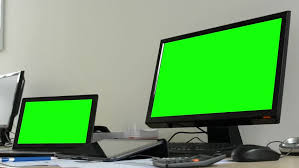 desktop computer and laptop in the office green screen closeup hd stock