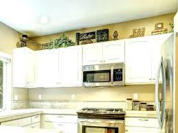 sensational ways to decorate kitchen cabinets how to decorate above your kitchen cabinets