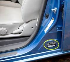 the black sticker shown circled in yellow in the lower right of the above photo is on the car body revealed when you open the driver s door