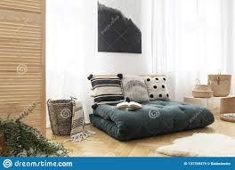 Futon Interior Design Green Futon With Pillows In Boho Bedroom Interior With