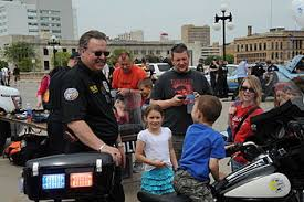 community policing  police officers interact the public in des moines iowa during police week 2010 community policing