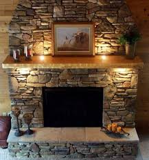 astonishing faux stone fireplace mantel shelves with stacked stone fireplace surround including antique pillar candle holders