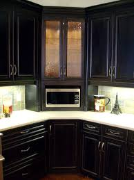 Corner built-in microwave cabinet, with glass door upper. Decorative turned  post columns