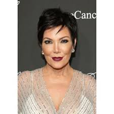 jenner wowed in a rare look for her bold berry lips and hair swept away from
