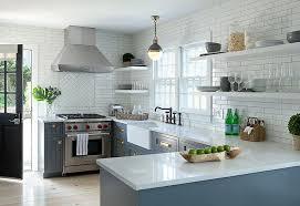 blue kitchen cabinets with vintage brass latch hardware under floating shelves