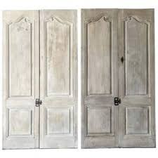 antique cabinet doors. two pairs of matching antique cabinet doors with reclaimed hardware