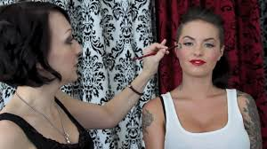pin up make up with cat eyes and a red lip on christy mack