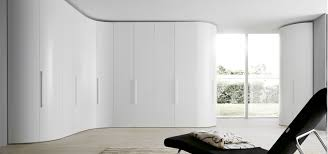 modern curved wardrobe in matt white lacquer with stilo modern handles