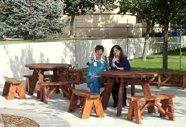 round wooden picnic tables detached benches