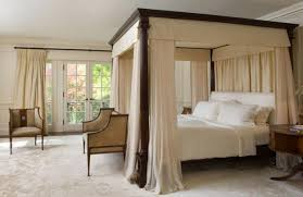 Metal bed with light canopy curtains