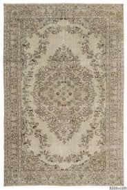 beige over dyed turkish vintage rug 6 4 x 9