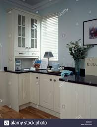 Small Fitted Kitchen Small Music Centre Below Fitted Cupboard In Modern Kitchen With