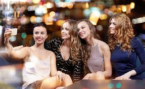 group of s taking a selfie at a nightclub