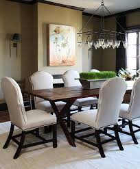 this 11 foot long pine table with a distressed surface is juxtaposed by curvaceous linen dining room chairsdining