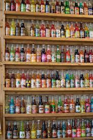 wall bar beverage drink bottle alcohol pop bottles shelves refreshment cola grocery soda pantry fizzy