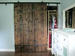 rural dark varnished hickory wood barn door with wrought iron embellishment interior doors plus rod near interior iron doors