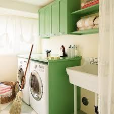 kelly green laundry room cabinets