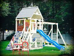 the wood was painted white and the playhouse was given faux red brick walls windows and window boxes overflowing with flowers and even climbing vines all