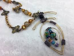 about two years ago i took a class at my local bead to learn how to make wire wrapped pendants i loved it it s fun and a lot easier than it