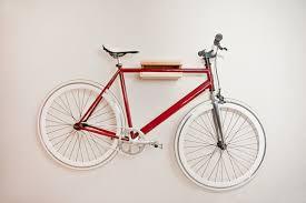 Functional and minimalist wall-mounted bike hanger.