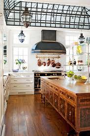 white traditional kitchen copper. Burl Wood Kitchen Island, White Cabinets, Sun Roof, Black La Cornue Stove And Hood, Copper Pots Pans // Traditional Kitchens N